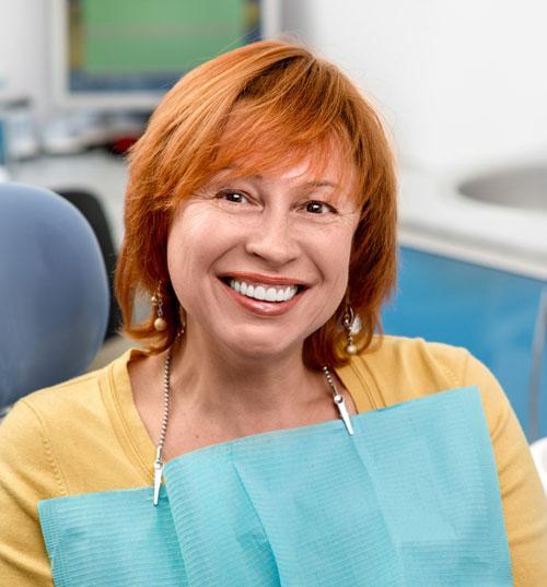 Senior woman in dental clinic
