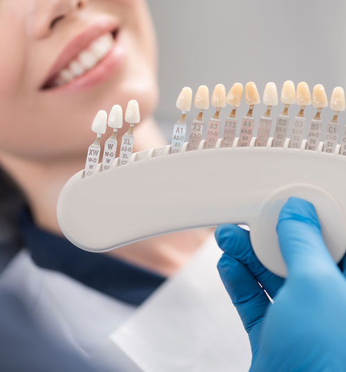 Dentist showing teeth implants to a patient